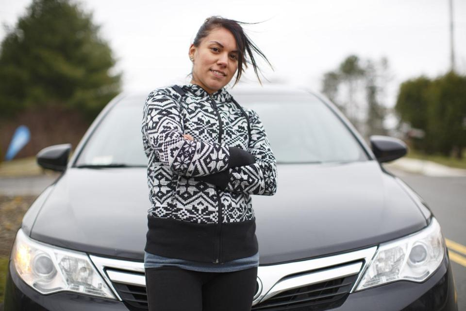 Jessie Cabel, a single mother who has been using Zemcar to transport her daughters, is also driving for the company.